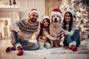 Family with dog at Christmas